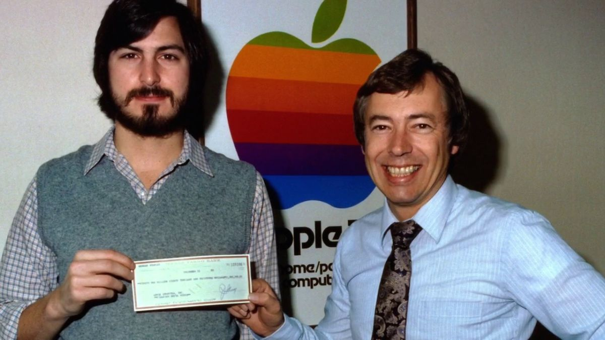 Steve Jobs and Mike Markkula with a cheque symbolising his investment in Apple, 1977