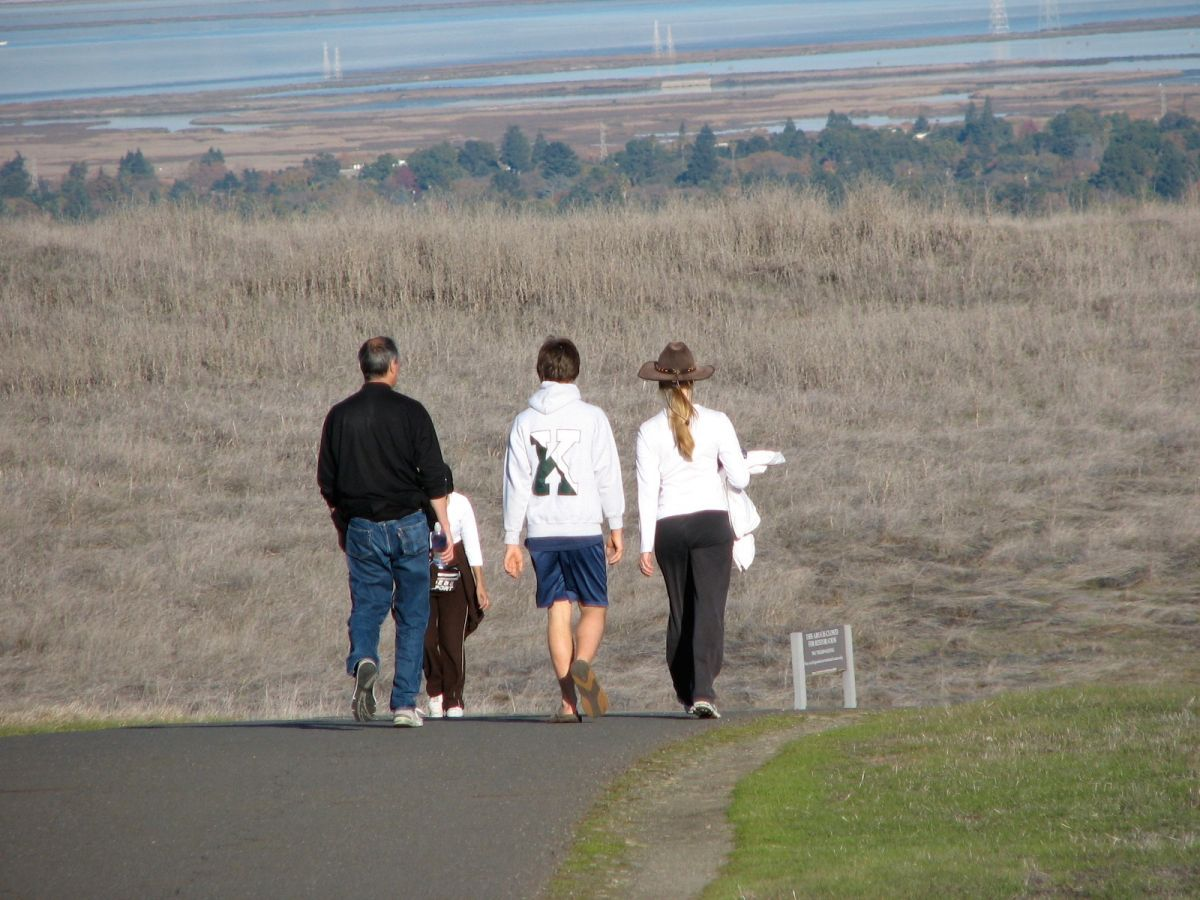 Steve and Laurene have a walk on the hills around Stanford with their son Reed, in late 2006