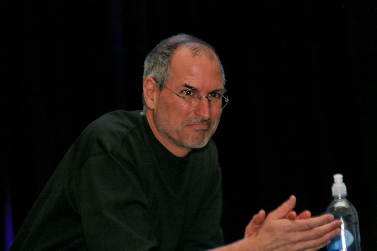 Steve Jobs watches as he hands over the stage