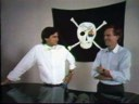 Steve Jobs and Apple CEO John Sculley by the Mac team's grand piano
