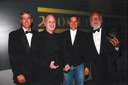 Steve Jobs surrounded by Ken Segall (left) and Lee Clow (right) of the TBWA\MAL ad agency, at the 2000 Effie Awards