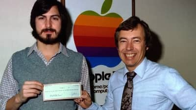 1977 - Steve Jobs and Mike Markkula with a cheque symbolising his investment in Apple