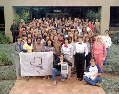 1984 - Steve poses with the Macintosh team outside their office