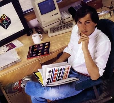 1986 - Steve at his NeXT office, pouring over designs of the logo